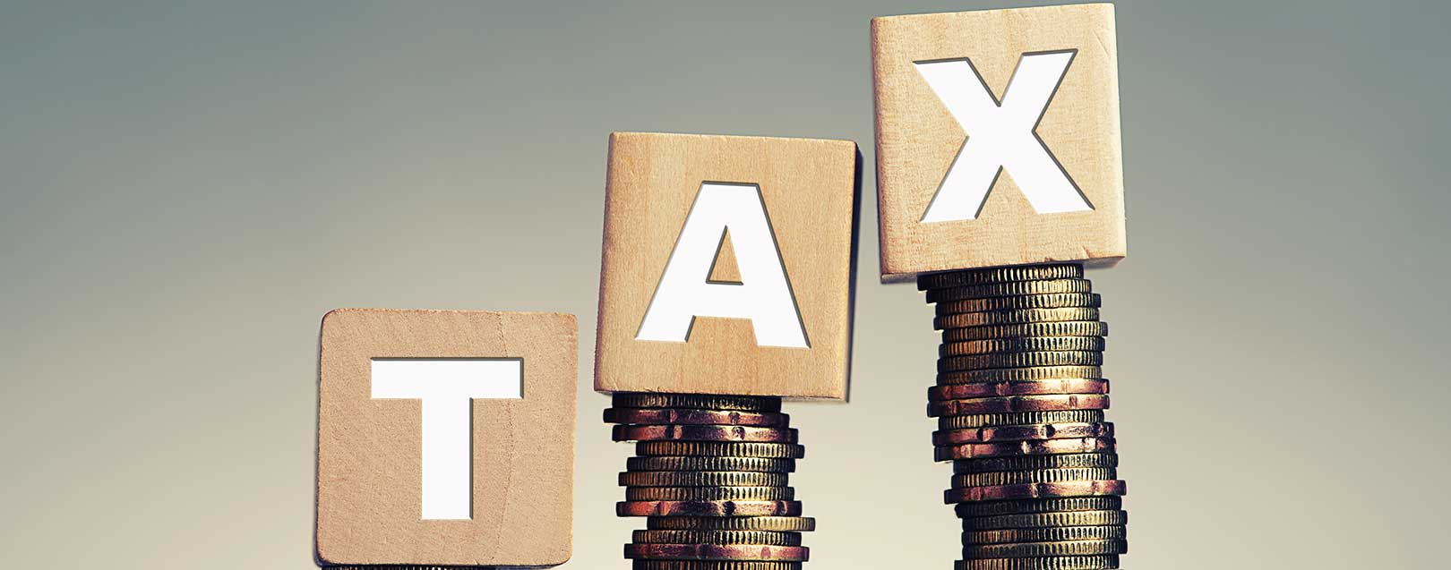Govt targets to rollout GST by April next year